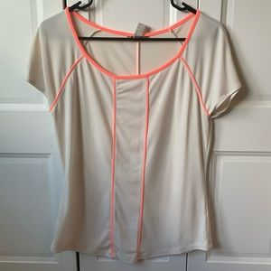 cream blouse with neon pink piping design
